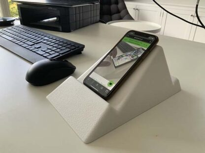 The Standii phone and tablet stand in cool white pictured in an office