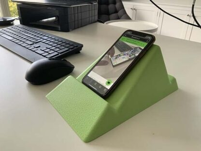 The Standii phone and tablet stand in lush green pictured in an office