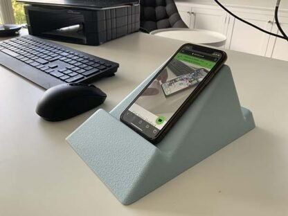 The Standii phone and tablet stand in sky blue pictured in an office