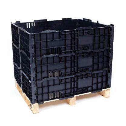 The Regen plastic pallet collar in black, stacked 3 high.